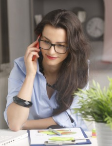 Young beautiful businesswoman working at home